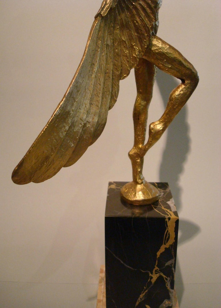 French Icarus, Art Deco Metal Sculpture of an Athletic Man with Stylized Wings For Sale