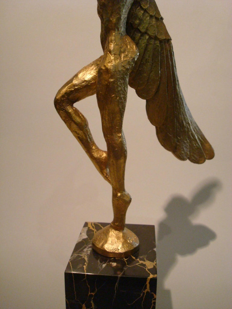 Marble Icarus, Art Deco Metal Sculpture of an Athletic Man with Stylized Wings For Sale