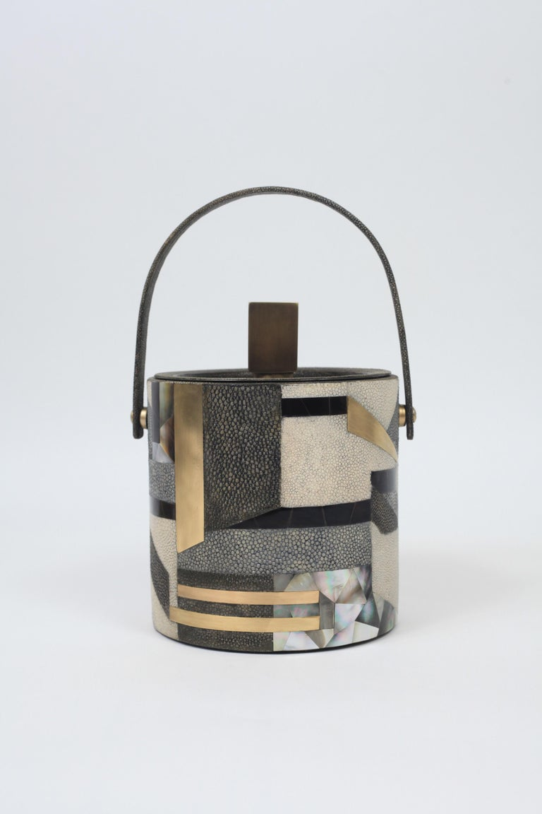 The KIFU PARIS ice bucket is the ultimate luxury bar accessory, inlaid in a mixture of shagreen shell and brass to create a bold geometric pattern. This piece comes with an ice thong. Also available in plain shagreen and plain shell, see images at