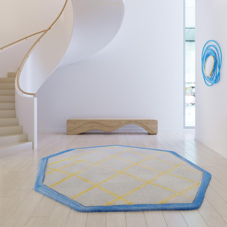 Crystal: Natural Perfection The Ice rug of the Frozen collection is an asymmetric octagon, symbolizing an ice crystal with its edges rendered by the designer in the form of crisscrossing shading. The bright blue contour accentuates the shape while
