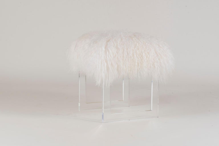 A custom longhair Icelandic woolly sheepskin Lucite bench.  Dimensions shown are of frame structure and do not include the poufing of the fur.  Measures: Finished frame is 20