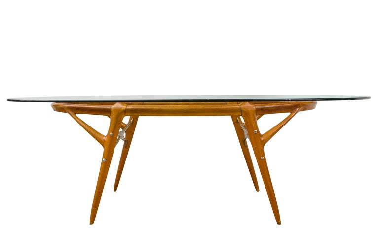 Italian Walnut and Brass Dining Table in the style of Ico Paroso, circa 1955. Ico Parisi was an Italian architect and designer born in 1916 in Palermo, Italy. He was involved in building construction and architecture in Como during his early