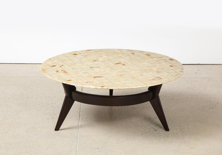 Rare circular cocktail table by Ico Parisi. Circular low table of dark stained mahogany with wide center stretcher. Rare 3-legged variant. Removable top of onyx arranged into a mosaic pattern. Produced custom by Brugnoli Mobili, Cantù. Published: