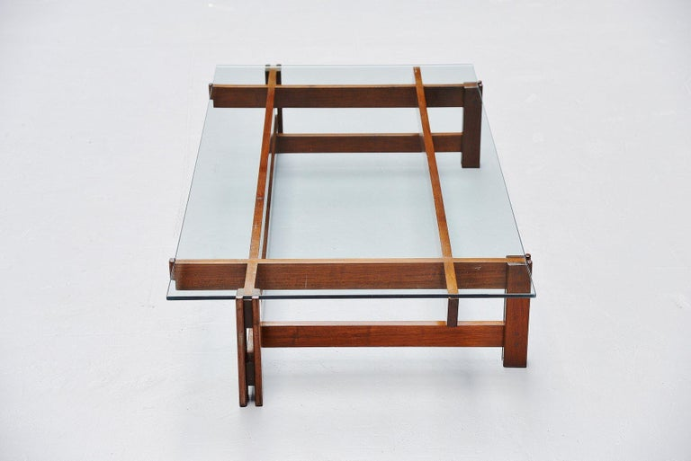 Architectural coffee table model 751 designed by Ico Parisi and manufactured by Cassina, Italy 1962. The table has a solid walnut wooden frame, composed by several slats and bars dowel connected very nicely, not screwed. The table is in stunning