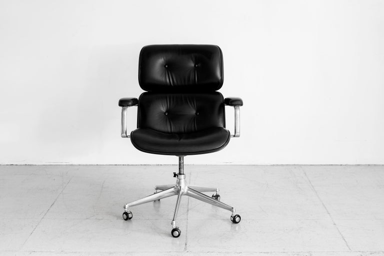 Handsome desk chair by Ico Parisi - manufactured by MIM, circa 1965 Cast aluminum base on casters with rosewood veneer back, black leather.  Impressive in scale.