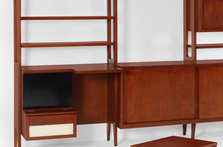 Library wall unit with rolling cart / table trolley was custom designed by Ico Parisi and Custom manufactured by Fratelli Rizzi SNC for an apartment in Como, Italy in 1958.   Italian walnut, enameled steel, laminate, lacquered wood ; 57½ w × 25¾ d ×