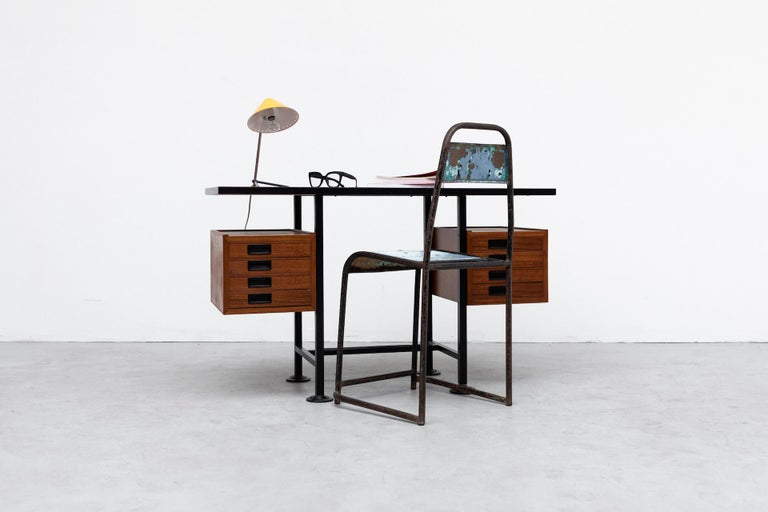 Ico Parisi inspired modernist desk or vanity with floating double stacked drawers and teak top on black enameled metal frame. Lightly refinished wood with original black acrylic inset handles. Wear is Consistent with it's age and use.