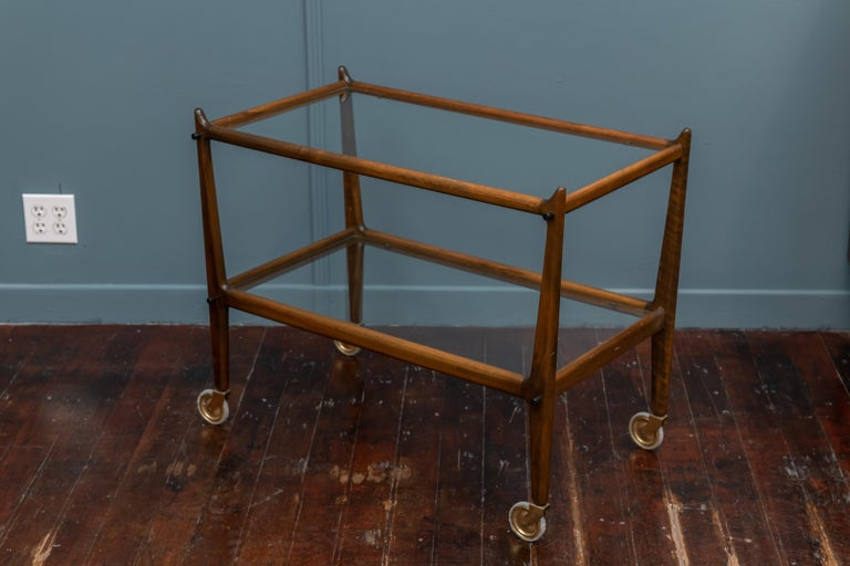 Ico Parisi sculpted fruitwood and glass rolling bar cart, good original condition.