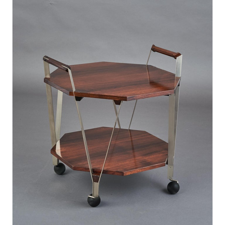 Ico Parisi, (1916-1996) An elegant modernist two-tier octagonal rosewood rolling cart with geometric handles, satin nickeled brass mounts Italy, 1959 Ref: Ico Parisi Catalogue Raisonné p.597 Size: 24 W x 24 D x 21 / 26 H.