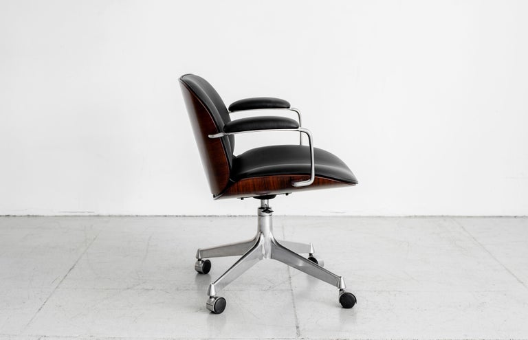 Office chair by Ico Parisi for MIM, circa 1960s. Aluminum base with curved plywood back and newly upholstered leather seat.  Multiple quantity available.