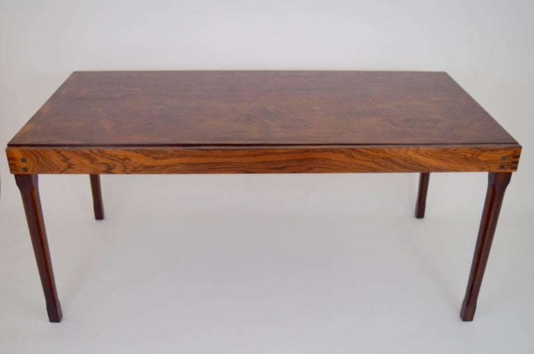 Rare Ico Parisi for M.I.M. rosewood expanding table. Sliding rectangular top reveals self stowed rotating extending leaf with delicate rosewood pull. Fluted leg details elegantly offset by apron finger joint corners. Lovely grain throughout, with