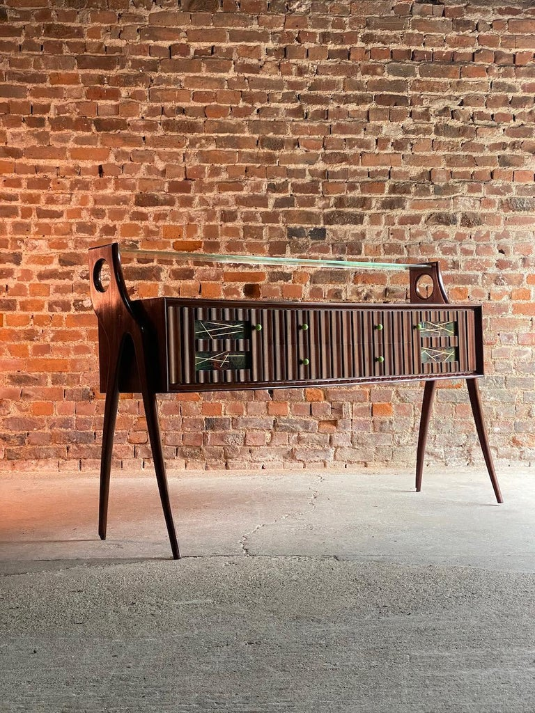 Ico Parisi walnut, Credenza, 1950  Sublime Italian Mid Century Modern Ico Parisi Walnut Credenza Italy circa 1950, the upper section with a clear glass shelf tenoned into stylised tall and elegant end legs, the suspended rectangular body with