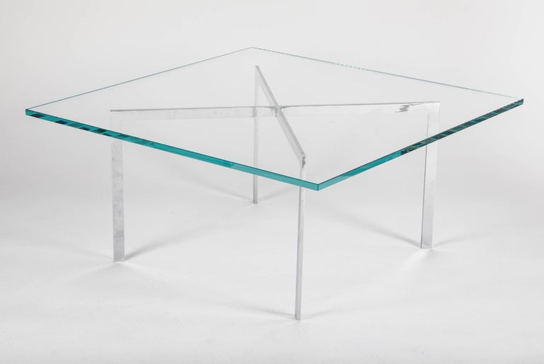 Iconic Barcelona coffee table with minimalist design, exemplary of the Bauhaus movement. Comprised of seamless architectural base with X form in polished chromed steel, with thick 3/4