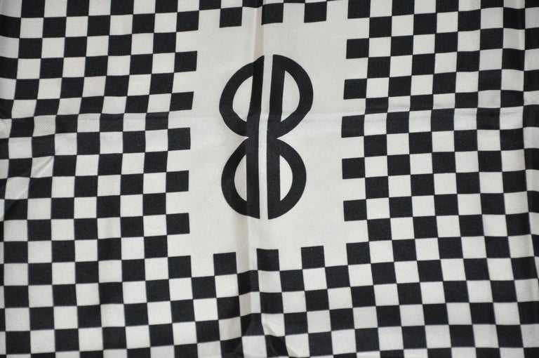 Iconic Bill Blass black & White checkered signature logo silk scarf measures 23 inches by 23 inches, with hand-rolled edges. Made in Italy.