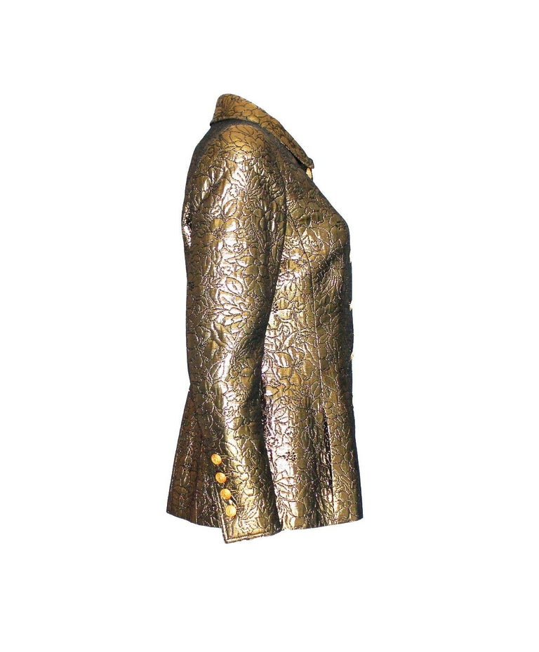"""A true icon designed by Karl Lagerfeld for Chanel Golden metallic jacket 3D structure Golden buttons with CC logo marked """"Chanel"""" on back Fully lined  Part of the AD campaign shot by Karl Lagerfeld Amazing condition Made in France Dry Clean"""