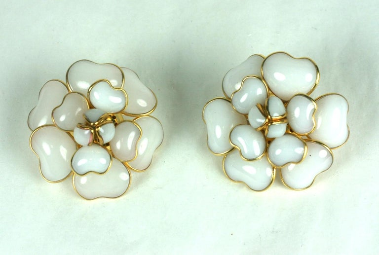Classic, Iconic Chanel Maison Gripoix white opal signature camelia poured glass ear clips. The handmade petals naturally and dimensionally layered.  Settings of hand made gilt bronze with hand poured glass. Clip back fittings. Chanel no longer uses