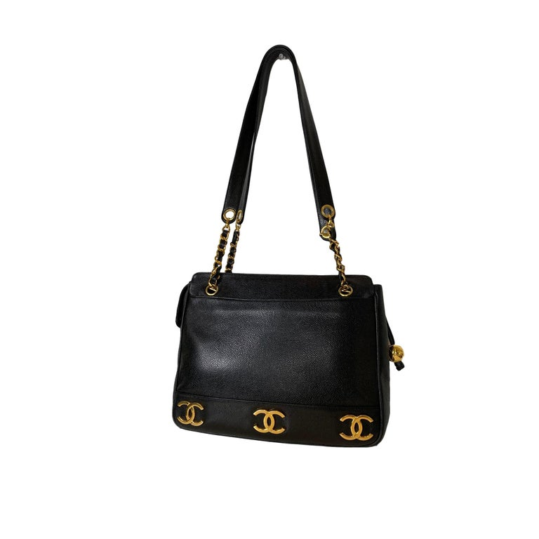 A rare and vintage 1994 Chanel Triple Logo Leather Shoulder Bag in black caviar leather and lambskin, adorned with three 24K gold-plated iconic 'CC' Logos on both sides of the bag.  The Chanel logo, arguably the most recognized logo in the world,