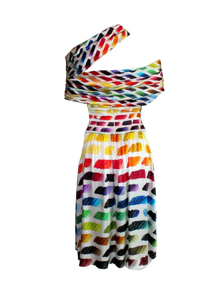 One of the most famous Chanel pieces of this decade Created by genius Karl Lagerfeld for Chanel This ensemble is a must have for any Chanel collector Beautiful multicolor printed silk Draped asymmetric top Corset-style skirt with slightly longer