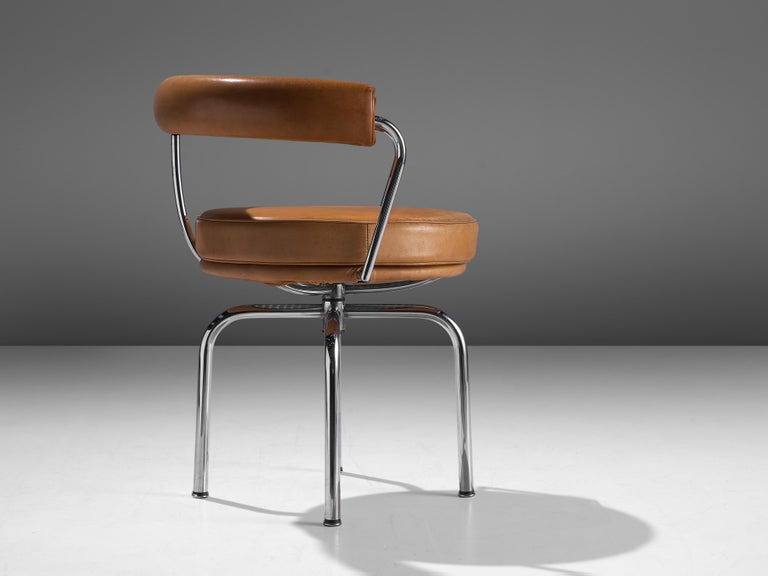 Italian Iconic Charlotte Perriand 'LC7' Swivel Chair in Tubular Steel and Cognac Leather For Sale