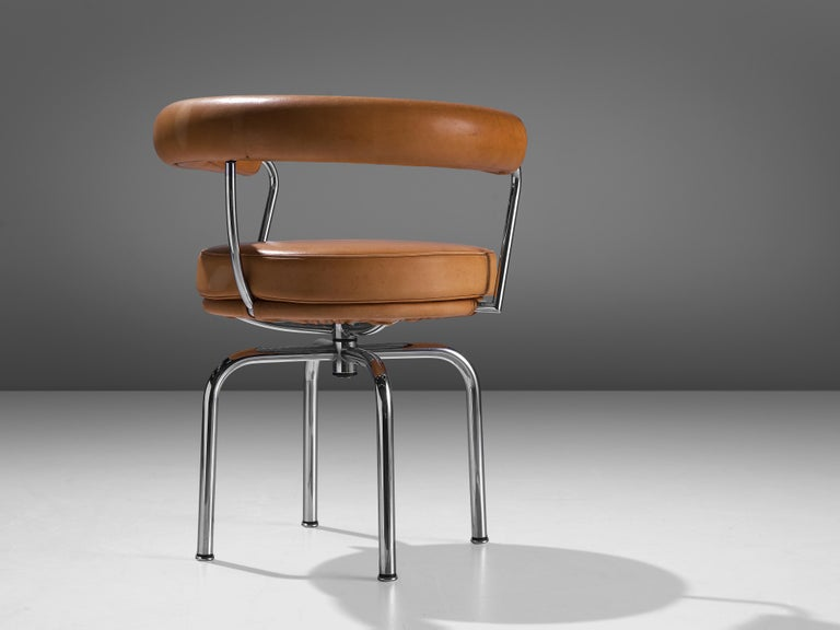 Late 20th Century Iconic Charlotte Perriand 'LC7' Swivel Chair in Tubular Steel and Cognac Leather For Sale