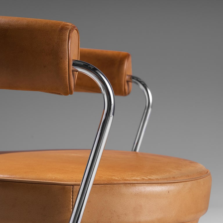 Metal Iconic Charlotte Perriand 'LC7' Swivel Chair in Tubular Steel and Cognac Leather For Sale