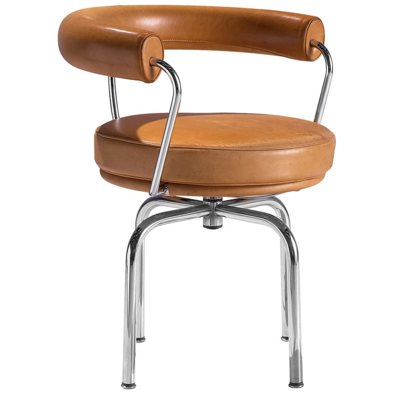 Iconic Charlotte Perriand 'LC7' Swivel Chair in Tubular Steel and Cognac Leather For Sale