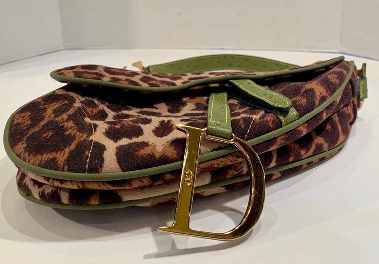 Bold and whimsical leopard print fabric saddle bag with oversized gold-tone logo