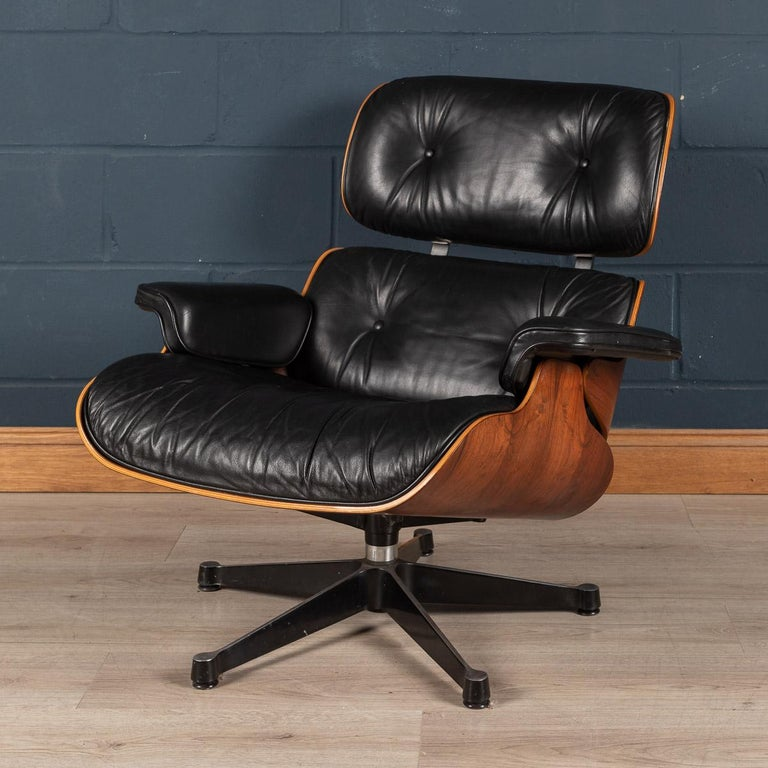 The Eames lounge chair and ottoman are furnishings made of molded plywood and leather, designed by Charles and Ray Eames for the Herman Miller furniture company. They are officially titled Eames Lounge and Ottoman and were released in 1956 after