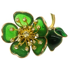 Iconic emerald poured glass 'camellia' brooch, Maison Gripoix for Chanel, 1960s
