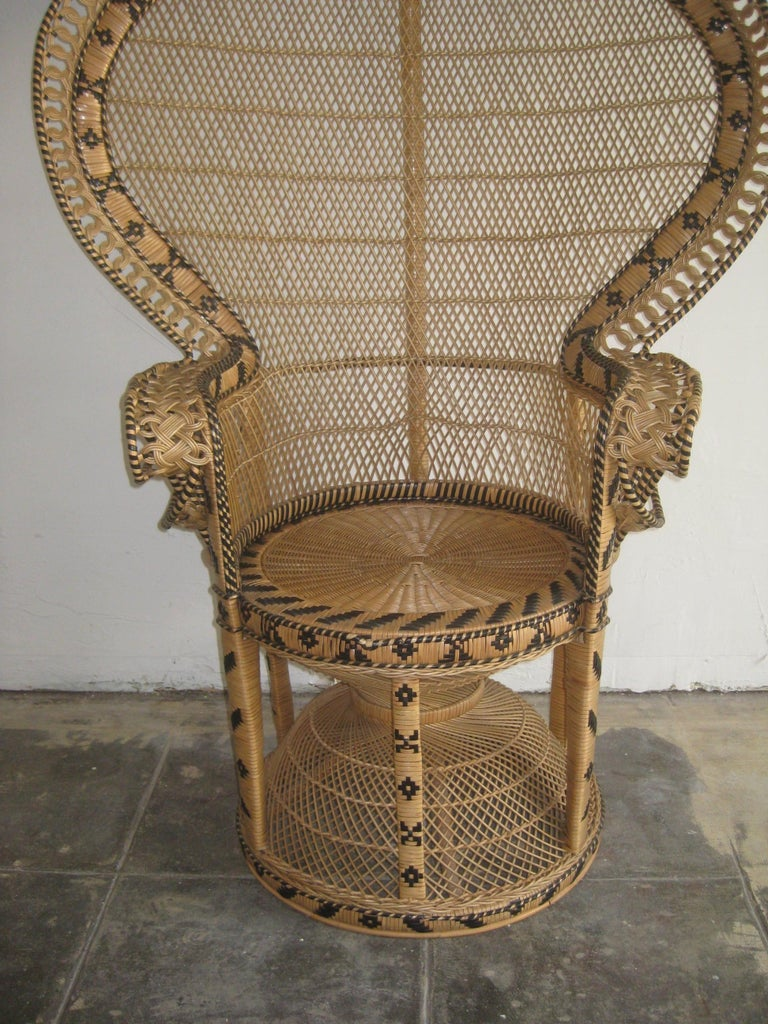 Iconic Emmanuelle wicker and rattan midcentury peacock chair. This chair is a statement piece and in mint condition. It has no broken, no brittle or repaired pieces. Displays well and is very strong. The color is awesome and would work in any