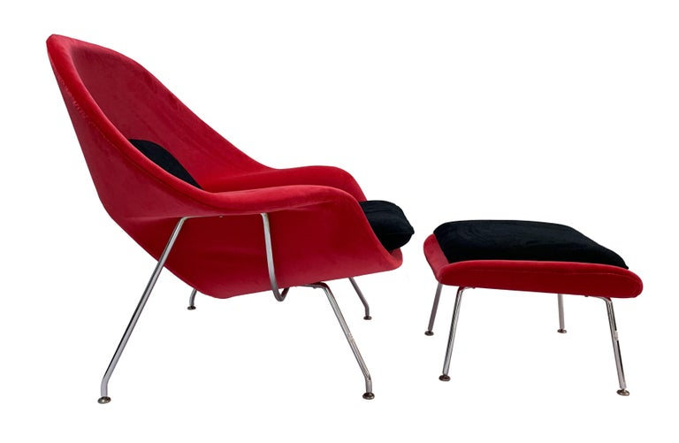 Iconic Mid-Century Modern Knoll womb chair and ottoman. Fully refurbished and reupholstered in a feisty Bernard Velluti red velvet with back and seat cushions in a Carlucci black velvet. The ottoman is covered in red velvet with a black cushion