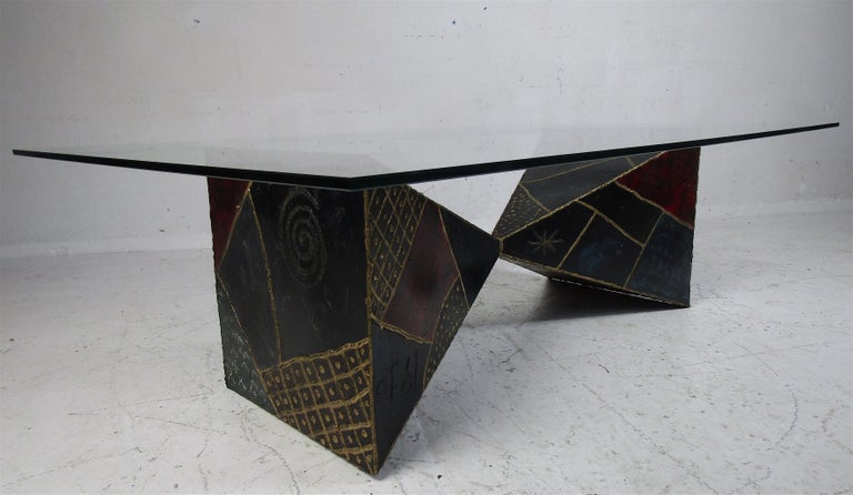 Stunning vintage modern welded metal base coffee table with a rectangular glass top. A sculptural base with two pyramid shaped welded together. The colorful design and thick glass top are sure to complement any modern interior. Paul Evans for