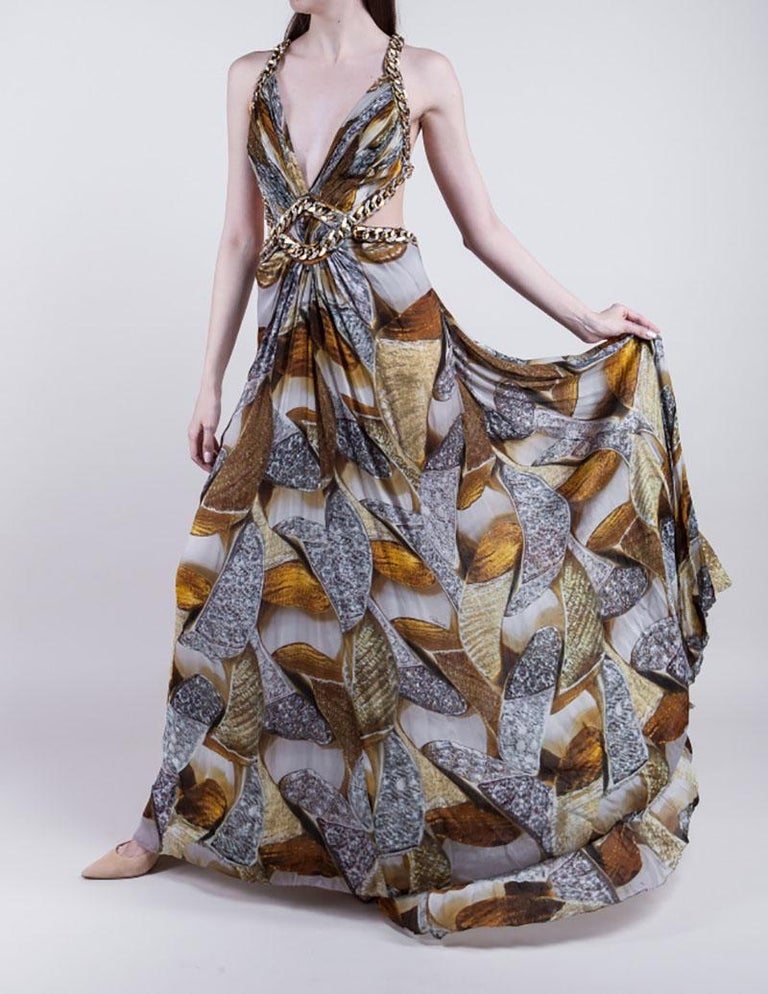 ROBERTO CAVALLI  Stunning gown with chain embellishment around the bodice  100% Silk Made in Italy  Iconic chain print Hidden back zip closure Deep V-Neck  IT Size 38  Pre-owned, in great condition