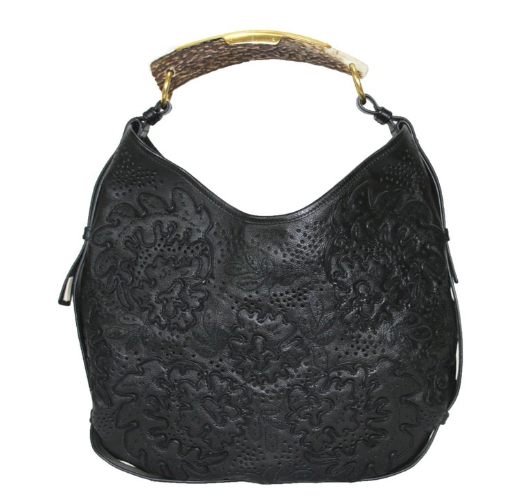 """Tom Ford's own words - """"What bamboo is to Gucci, horn is now to Saint Laurent."""" The deer horns YSL uses in the Tom Ford-designed bags popularized by Gwyneth Paltrow are naturally shed.  Nicole Richie and Jessica Simpson Favorite Bag. Iconic Tom Ford"""