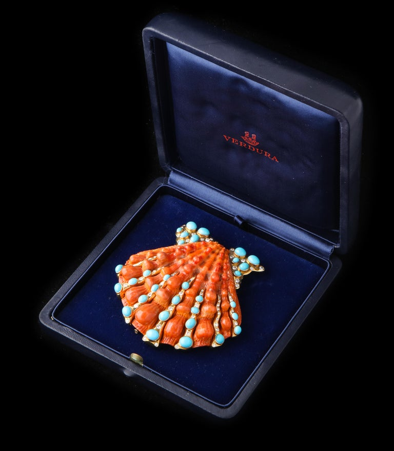 Iconic Verdura Shell Brooch  One of Fulco Verdura's most iconic designs in this very large lions paw shell brooch set in 18 karat gold with turquoise and diamonds.  With original box and certificate of authenticity.  Literature: For sketch of