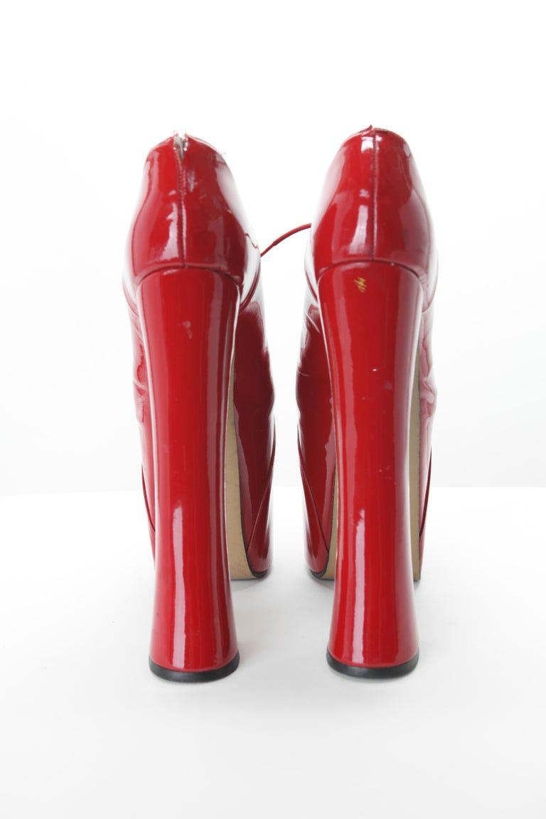 Iconic Vivienne Westwood Elevated Court Shoes c. 1993  The super elevated court shoes by Westwood were first shown on the catwalk in 1993 and were made famous by 90s super model Naomi Campbell after falling over on the runway wearing the