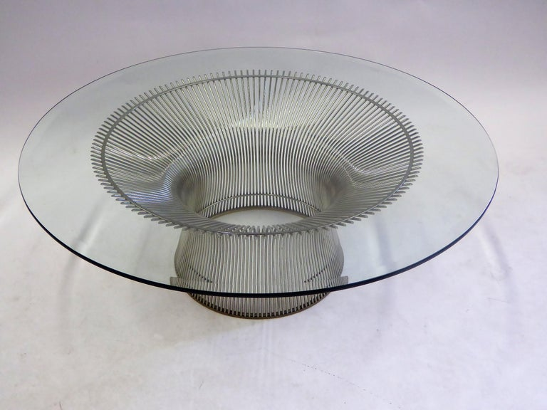 From the Warren Platner collection for Knoll, his unique design from 1966, is this nickeled steel table of upsweeping rods creating a fountain like form topped with the larger choice 42 inch bevelled edge glass. Magnificent coffee table, always a