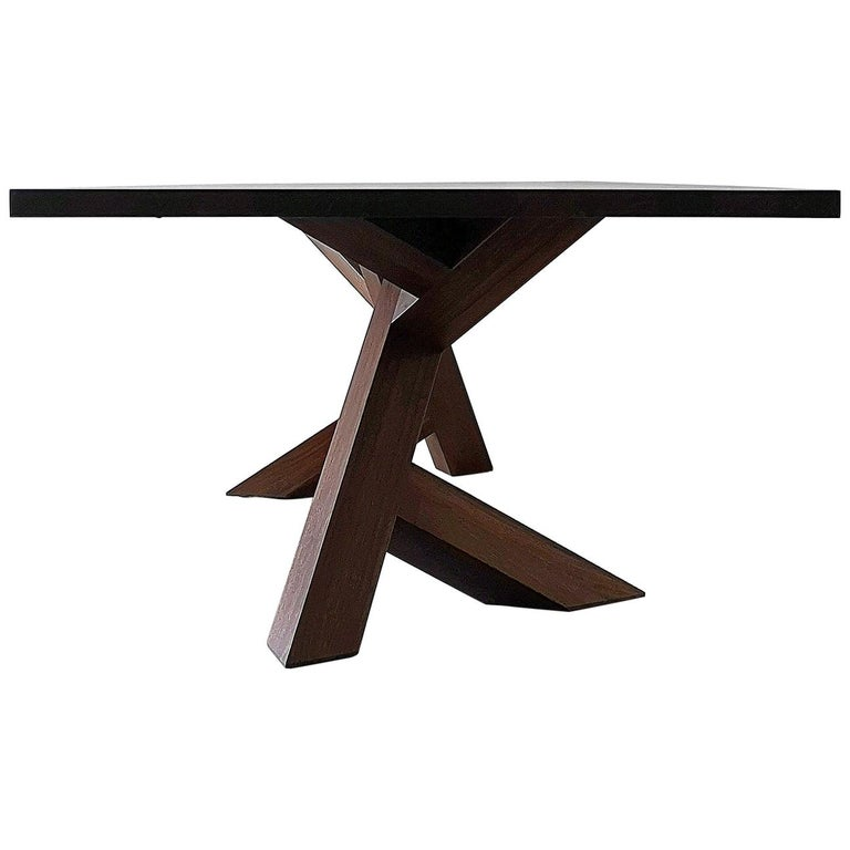 The Iconoclast dining table is made of 100% solid, hardwood and features a unique pedestal base. This piece commands attention and is the perfect centre piece for any open plan dining room, from modern to transitional, also makes a powerful