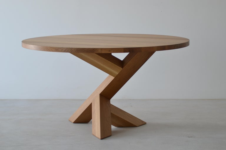 This iconic pedestal dining table can be made rectangle or round and is 100% solid hardwood. It's angular base allows for myriad chair placement while and providing maximum stability. Can be made up to 60