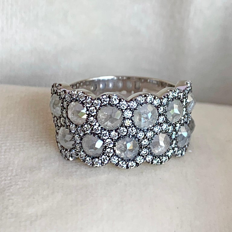 One of a kind Alliance ring handmade in Belgium in 2017 by jewellery artist Joke Quick, in 18K white gold 9 g. Set with 12 Icy rose-cut diamonds and 102 white DEGVVS brilliant-cut diamonds. Total carat diamonds: 5,42 carat. Size EU 54  US 6 3/4 .