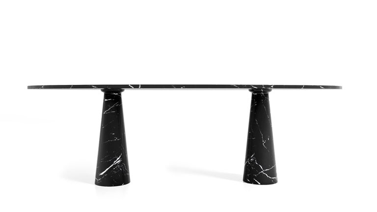 Contemporary oval dining or conference table made out of pure marble top and base. Christophe Pillet who has won international acclaim for the spectrum and quality of his creations designed the simplest most elegant table that fits equally in