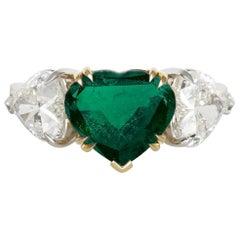 Igi Antwerp 4.47 Carat Three Stone Heart-Cut Natural Green Emerald Diamond Ring