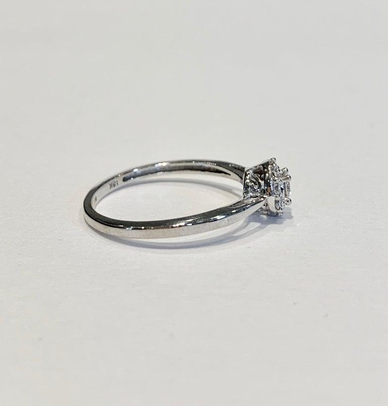 Modern IGI Certified 0.25 Carat Diamond Cluster Ring in 18 Carat White Gold For Sale