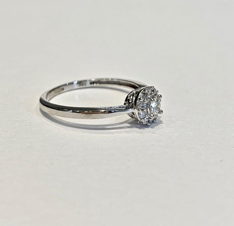 Round Cut IGI Certified 0.25 Carat Diamond Cluster Ring in 18 Carat White Gold For Sale