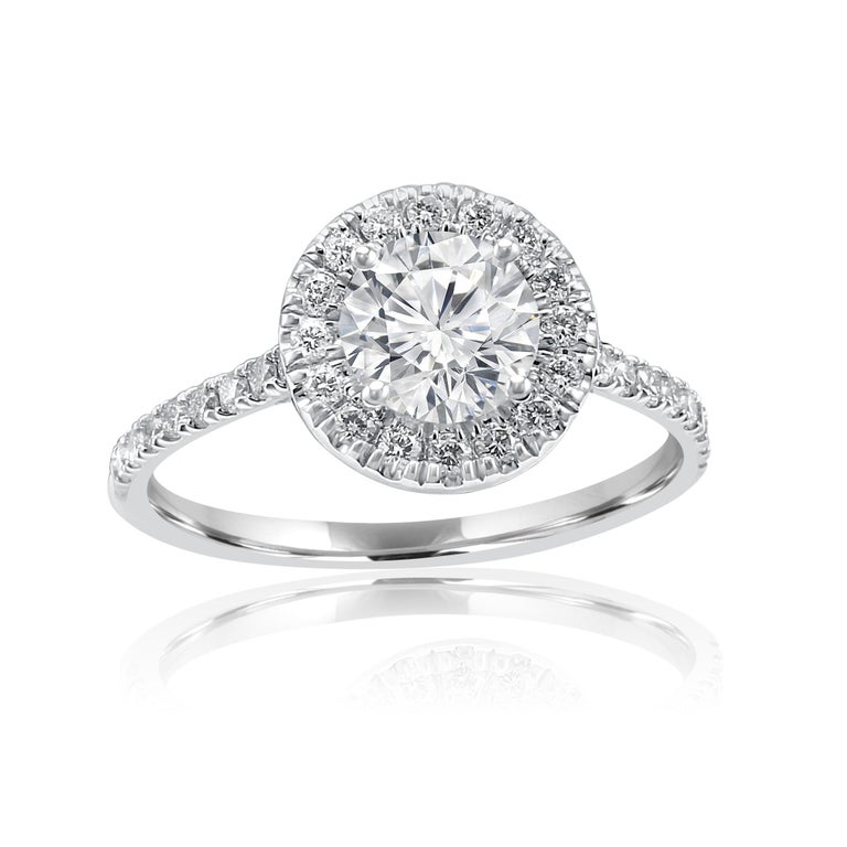 Stunning 1.01 Carat Round G color SI-I1 Clarity  Center encircled in a single Halo of White Round Diamonds 0.50 Carat in 14K White Gold always in style single shank ring  MADE IN USA Total Diamond Weight 1.51 Carat MATCHING BAND AVAILABLE.  Style