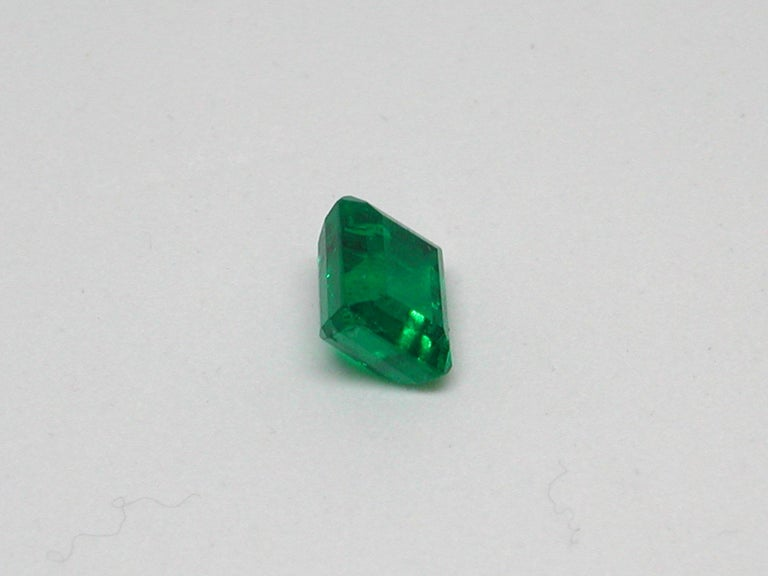Emerald Cut IGI Certified 10.42 Carat Colombia Green Emerald For Sale