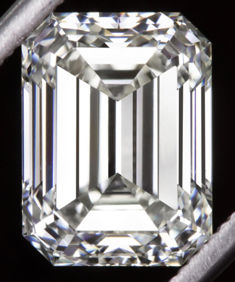 Elegant, high quality, and quite substantial 2.54ct emerald cut diamond has excellent VS2 clarity, beautiful white color, and a bright, lively, sophisticated cut! The diamond is certified by IGI, the world's premiere gemological authority. Under