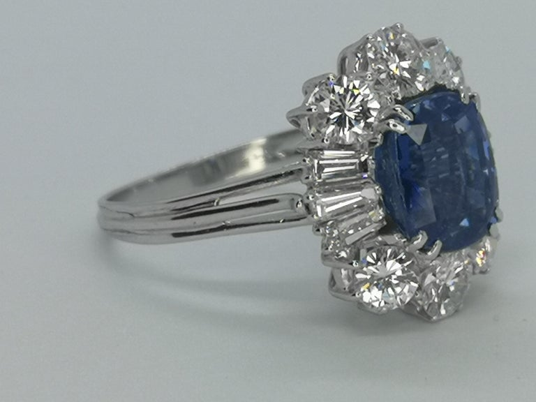 One of a kind Natural Unheated Sapphire and Diamond Ring made in Italy and certified by Igi Antwerp.   The main stone has an amazing clarity consider this color is so bright is very difficult to find without any treatment. You can see with a