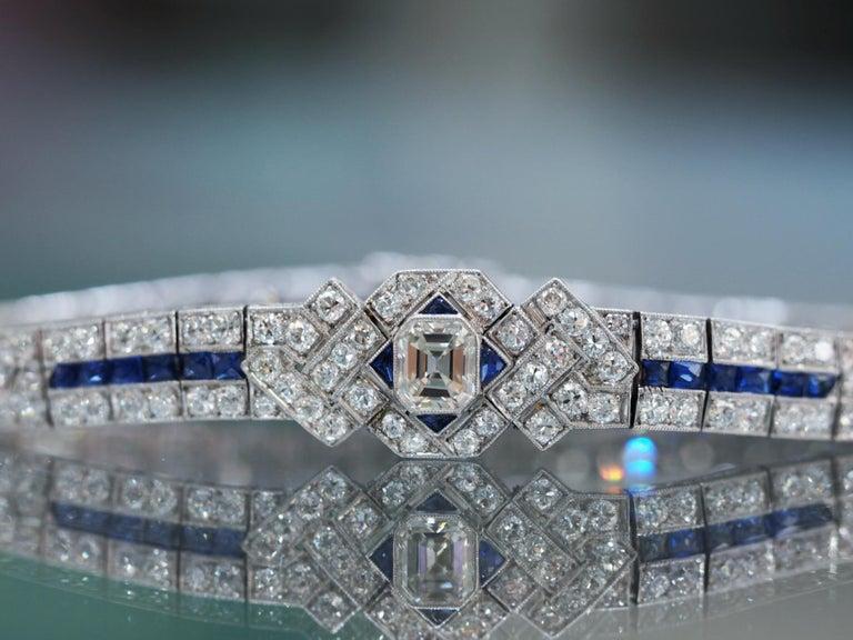 Emerald Cut IGI Certified Art Deco Platinum Diamond and Sapphire Bracelet For Sale