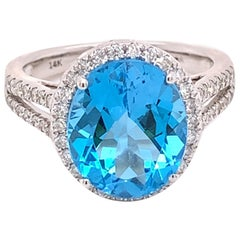 IGI Certified Oval Blue Topaz and Diamond 14k White Gold Halo Ring
